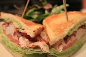 Slow roasted turkey club with double smoked bacon, basil aioli, avocado, tomato, romaine and toasted campagne bread.
