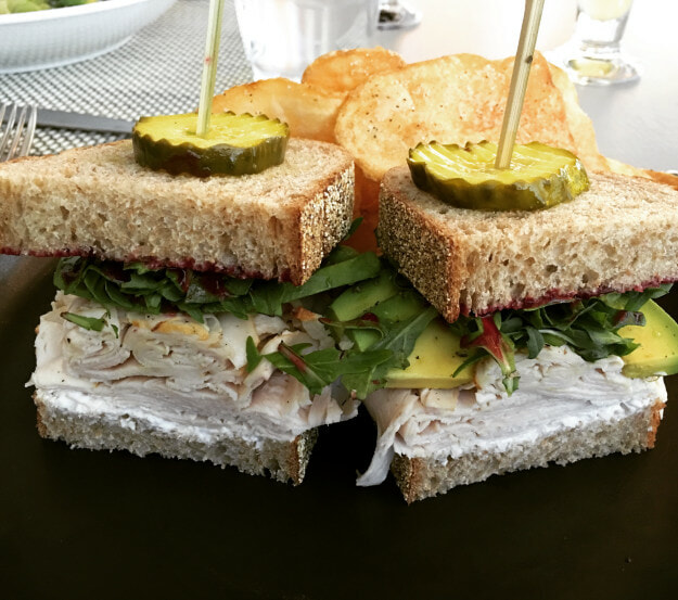Roasted Organic Turkey sandwich with avocado, arugula, cranberry jam and horseradish