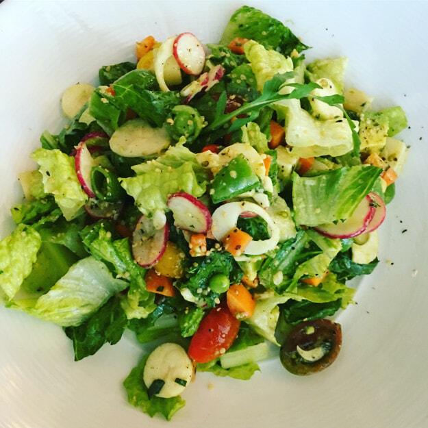 Chopped Salad with romaine, avocado, radish, heart of palm, aged cheddar, hemp seeds, tarragon & white balsamic vinaigrette